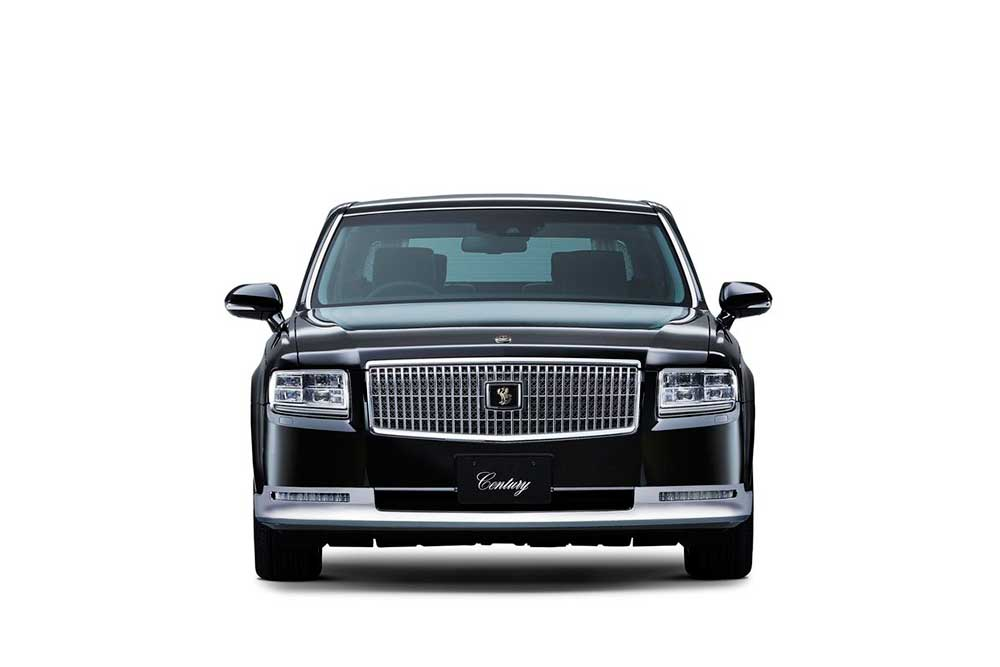Front view of the 2018 Toyota Century HYBRID, a large chrome grll encases the Toyota Century which is a mythical japanese bird, the Fushichō. Headlights are now triple projectors. - 2018 Toyota Century HYBRID The Ultimate in JDM Luxury